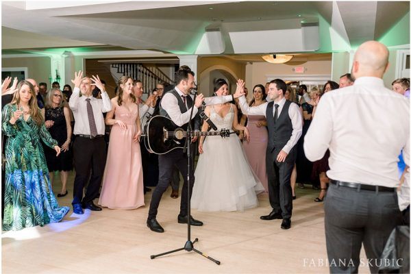 Jay singing on wedding